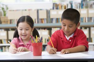 Copy-of-bigstock_Two_Students_In_Class_Writing_3917485