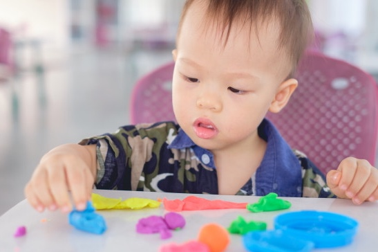 cute-little-asian-18-months-old-toddler-baby-boy-child-having-fun-playing-colorful-modeling-clay-play-dought-play-school-child-care-educational-toys-kid-creativ